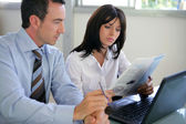 Businesspeople going over document — Stock Photo