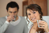 Couple drinking glass of water — Stock Photo