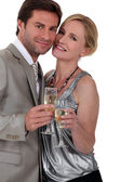 Couple with champagne glasses — Stock Photo