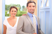 Couple arriving home — Stock Photo