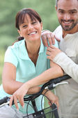 Man and woman with bike — Stock Photo
