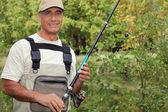 Freshwater fisherman — Stock Photo