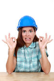 Woman with helmet and face of disgust — Stock Photo