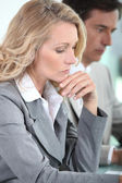Woman thinking in meeting — Stock Photo