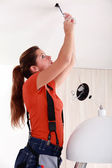 Portrait of a woman doing electricity work — Stock Photo
