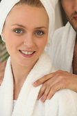 Blonde woman wearing a dressing gown — Stock Photo