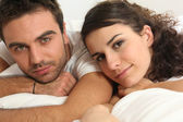Young resting in bed — Stock Photo