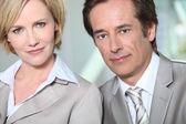 Male and female executives — Stock Photo