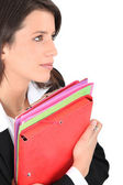 Brunette with files — Stock Photo