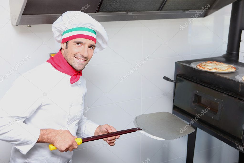 A pizza cook in front of an oven — Stock Photo #8957857