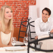 Man observing pretty lady in a restaurant — Stock Photo