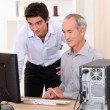Grandfather and grandson working together on a computer — Stock Photo