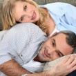 Sweet couple embracing on couch — Foto Stock #8960842