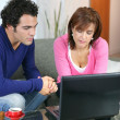 Stock Photo: Couple searching internet
