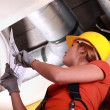 Stock Photo: Womchecking ventilation system