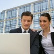 Business couple outside place of work — Stock Photo