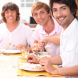 Roommates eating pizza — Stock Photo