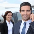 Successful businessman in airport — Stock Photo