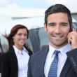 Stock Photo: Successful businessmin airport