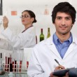 Two scientists in wine testing facility — Foto de Stock