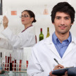 Two scientists in wine testing facility — Stok fotoğraf