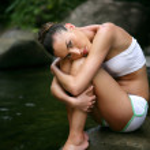 Model sat on rock in stream — Stock Photo