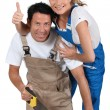 Couple stood by work bench doing home improvements — Stock Photo