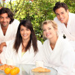 Friends having breakfast in a garden — Stock Photo #8961989