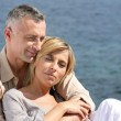 Happy married couple by the sea — Stock Photo
