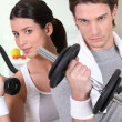 Young woman and young man healthy with barbells — Stock Photo