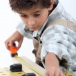Boy doing carpentry — Foto de stock #8962159