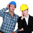 Female architect looking annoyed and foreman by her side — Stock Photo #8962468