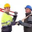 Workmen shaking hands - Stock Photo