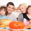 Stock Photo: Young family carving pumpkins