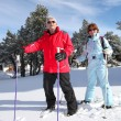 Senior couple on a ski vacation — Stock Photo