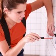 Female electrician installing a wall socket — Stock Photo #8962877