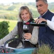 Couple drinking wine in vineyard — Stock Photo #8962907
