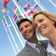 Royalty-Free Stock Photo: Businesspeople with flags.
