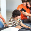 Teenage friends hanging out at home - Stock Photo