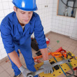 Stock Photo: Plumber preparing plastic piping