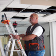 Electrician working on ceiling — Stockfoto