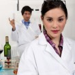 Two scientists making experienced on wine. — Stockfoto