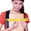 Woman measuring width of laminate flooring — Stock Photo #8963510