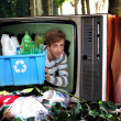 Man in television with recyclable plastic bottles - Stock Photo