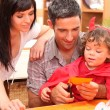 Little boy and parents preparing Halloween party — Stock Photo