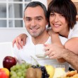 Husband and wife having breakfast — Stock Photo