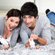 Young couple playing video games — Stock Photo #8963648