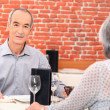 Senior couple eating a meal in a restaurant — Stock Photo