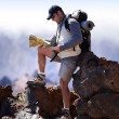 Hiker watching plan - Stock Photo