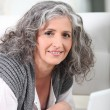 Healthy senior woman using laptop — Stock Photo #8963806